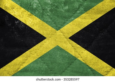 The concept of national flag on stitched canvas background: Jamaica