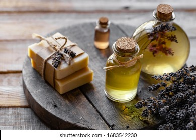 Concept of natural handmade home cosmetics with organic oil for gentle skin care. Pleasure, relax, anti-stress. Atmosphere of harmony and serenity.  Wooden rustic background, closeup, copy space