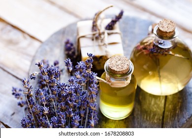 Concept of natural organic oil in cosmetology. Moisturizing skin care and aromatherapy. Gentle body treatment. Handmade soap. Atmosphere of harmony relax. Wooden background, lavender flower copy space - Shutterstock ID 1678208803