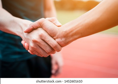 Concept of Negotiating business or competition and handshake Gesturing People Connection Deal. close up hand of young man shaking hands with rival or partner or customer on modern outdoor,fair play