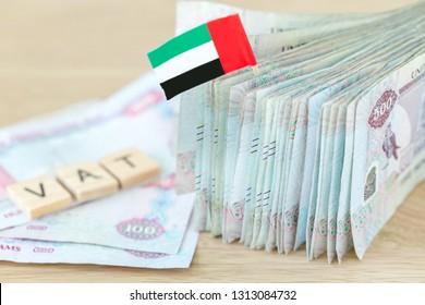 Concept on VAT in UAE. Stack of five hundred bills, dirhams, closeup.