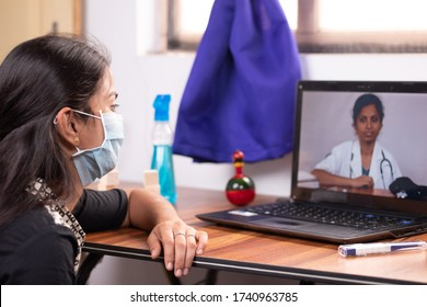 Concept of Online Chat, telehealth, or tele counseling with Nurse or Doctor on Screen during coronavirus or covid-19 pandemic - Girl in medical mask listining to doctor on laptop at home. - Shutterstock ID 1740963785