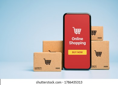 Concept online Sopping. boxes and shopping bag with Smartphone Online Shopping screen.