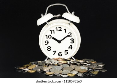 Concept of Opportunity cost time is money clock and coins with black background