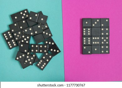 The concept of order and chaos. Chaotic disorganized dominoes and ordered dominoes on colored cardboard background