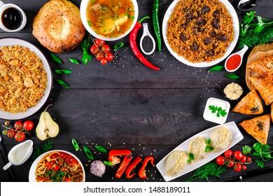 The concept of oriental cuisine. Assorted Uzbek food set, pilaf, samsa, lagman, manta, shurpa Uzbek restaurant concept, Uzbek food. Homemade Uzbek pilaf or plov from lamb served in cast iron cookware