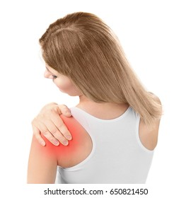 Concept of orthopedist. Woman suffering from pain in shoulder on white background