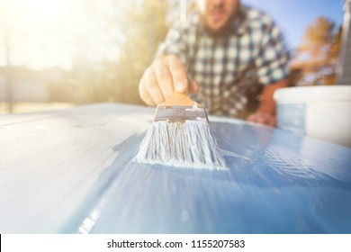 Concept of painting woodwork outside