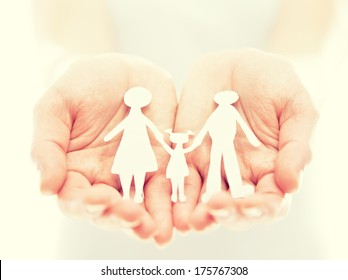 concept. paper figures of family in the hands