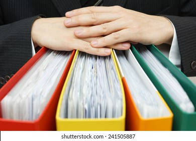 concept of paperwork,accounting, administration businessman holding documentation