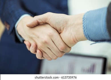 concept of partnership in business: a handshake of business partners