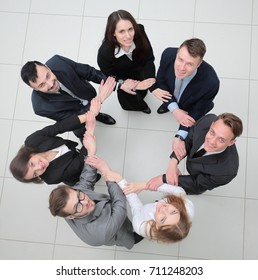 concept of partnership. business people standing in a circle.