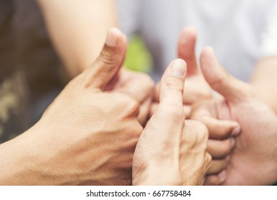 Concept partnership. Four volunteer Partners Team with hands together. Hand Holding of business partners.Trust business in authentic of people.