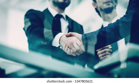 concept of partnership - handshake of business partners