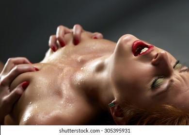 Concept of passion. Sensual woman has orgasm