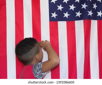 Concept of patriotism,4th july, independence day and national. A child saluting an american flag.