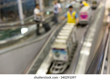 Concept people on escalator at the airport in blur motion background