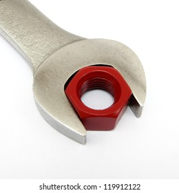 Concept of perfect fit.  Using a red hexagon nut and wrench to convey abstract theme.