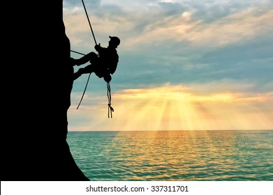 The concept of perseverance. Silhouette climber steadily climb the mountain