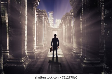 The concept and perspective of business people, the growth of business.businessman standing in Ancient Ruins looking at the city