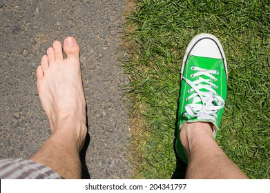 concept photo of barefoot versus wearing sneakers grass versus asphalt