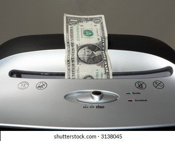 concept photo of a dollar bill being shredded by a paper shredder depicting the weakened dollar value