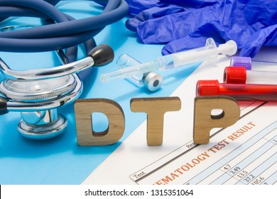 Concept photo DTP (or DPT) - diphtheria, tetanus, pertussis - vaccine or vaccination process of children. Abbreviation DTP is against background of ampoule with vaccine, syringe, stethoscope, blood