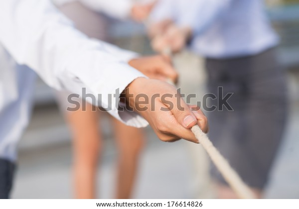 Concept photo of a leader using a rope as teamwork on the foreground