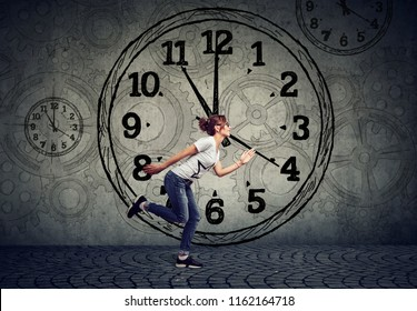 Concept photo of a woman in hurry running against time. Young girl running out of time