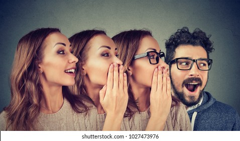 Concept photo of women and man in row sharing with rumour in amazement whispering.