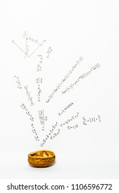 Concept of the phrase mathematics in a nutshell. Mathematical formulas drawn on white paper with walnuts