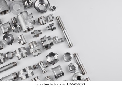 Concept of plumbing tools and accessories on a white background with copy space