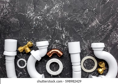 concept plumbing work top view on dark background