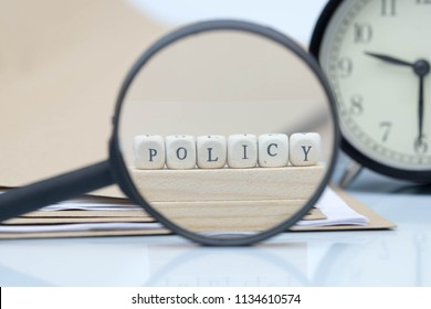 The concept of policies. Words use blocks of wood on files and documents. Selective Focus.