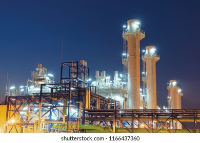 Concept Pollution and industrialization . Details of oil pipelines with valves in large oil refineries, in sunrise time refining equipment, close-up of industrial pipelines of oil refineries.
