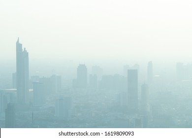 Concept of Pollution PM2.5 Unhealthy air pollution dust. Toxic haze in the city. Photos in the capital on a skyscraper.
