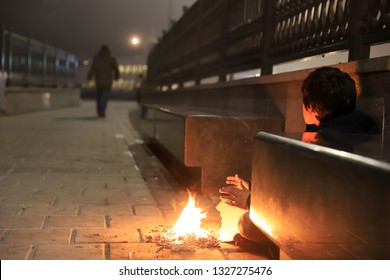 Concept of poverty, human warmth, hands that help, hard life, urban life.