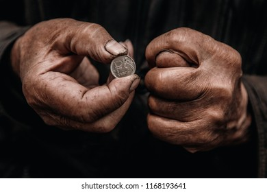 Concept poverty Sanction in Russia. Old man hands hold ruble
