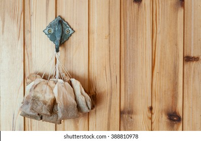 The concept of poverty. Used tea bags drying on the wall