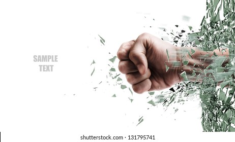 concept. power fist coming out of cracked glass isolated on white background