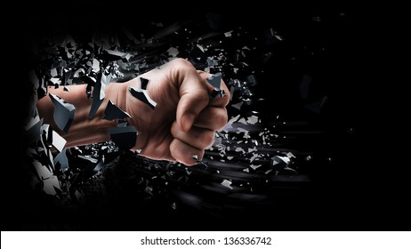 concept. power fist coming out of cracked ground isolated on black background