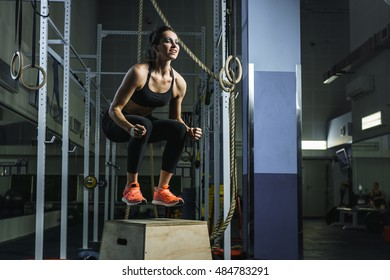 Concept: power, strength, healthy lifestyle, sport. Powerful attractive muscular woman CrossFit trainer do jumps during workout at the gym