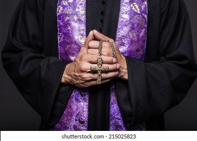 Concept: prayer.  Studio shot on black background
