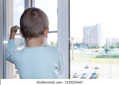 The concept of protecting a child from falling out of a window. The child opens the window close up