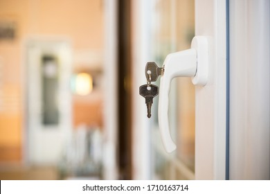 The concept of protecting a child from falling out of windows. Handle with a lock on the window.
