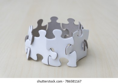 concept puzzle on wooden table. Business teamwork and collaborate concept.