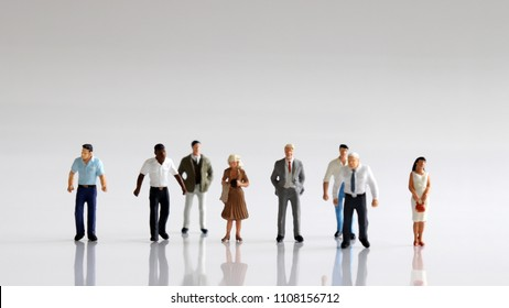 The concept of racial discrimination in employment and recruitment. A variety of miniature people.