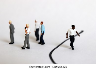 The concept of racial discrimination within the organization. Miniature people.