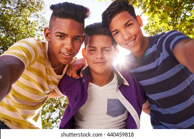 Concept of racism and integration. Portrait of happy boys smiling looking at camera.