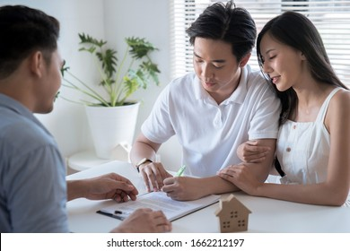 Concept of real estate trading, The customer is signing a contract to buy real estate.
